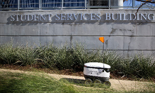 A Starship Technologies robot fulfills a delivery on the UT Dallas campus.